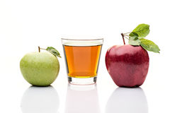Red and green apple. glass of juice.  on white Stock Images