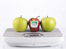 Red and green apple with measurement tool Stock Images
