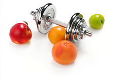 Red and green apple, orange citrus, grapefruit and dumbbell Stock Image