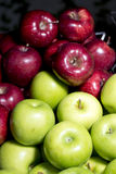 Red and green apple in steel basket Stock Images