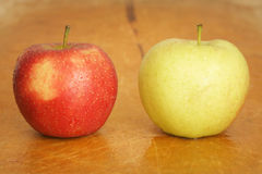 Red and green apple on wooden Stock Images