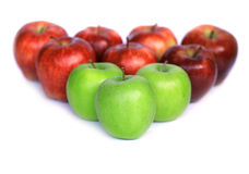 Red and green apples. Triangle of red and green apples isolated on white Royalty Free Stock Photos