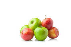 Red and green apples. Ripe juicy red and green apples on a white background Stock Photography