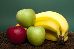 Red and green apples and bananas Royalty Free Stock Photos