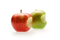 Red and green apples with bite. On white Stock Images