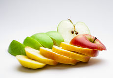 Red and green apples chopped Stock Photos