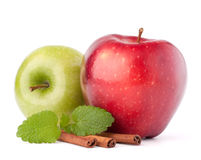 Red and green apples, cinnamon sticks and mint leaves still life Stock Photography