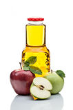 Red and green apples and juice bottle  on white Stock Photography