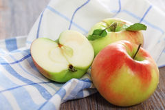 Red and green apples with leaves Stock Image