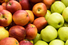 Red and green apples. In the market Stock Images