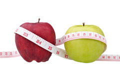 Red and green apples with measure tape Stock Image