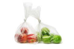 Red and green apples in plastic bags Stock Photography