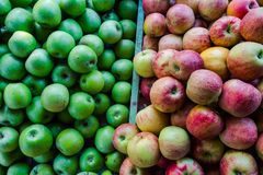 Red and green apples in a tray on the grocery market royalty free stock photography