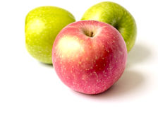 Red and green apples. On white background Stock Photos