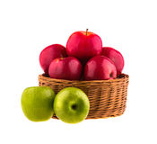 Red and green apples in a wooden basket Royalty Free Stock Photos