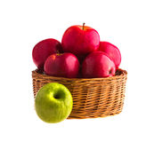 Red and green apples in a wooden basket Royalty Free Stock Image