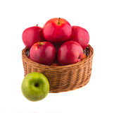 Red and green apples in a wooden basket Stock Photography