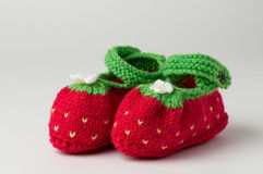 Red and Green Baby Booties. A pair of knitted red and green baby boots  on white background Stock Images