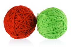 Red and green balls of yarn Stock Images