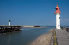 Red and green beacon. S at the end of the sea port. leading ships safety back to the port Stock Photography