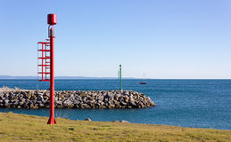 Red and Green Beacons on the Shore Stock Image