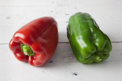Red and green bell peppers Royalty Free Stock Image