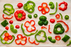 Red and Green Bell Peppers slices stock photos