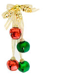 Red and green bells with gold ribbon. Colorful Ribbons and christmas bells isolated on white Royalty Free Stock Photography