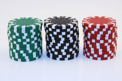Red Green and Black Chips. Gambling chips in red, green and black piles stock photos