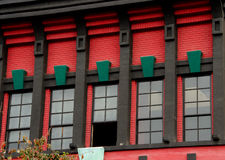Red, green and black details of a Victorian building in Gaslamp Stock Image