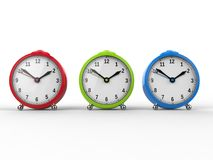 Red, green and blue alarm clocks. Isolated on white background Stock Photography