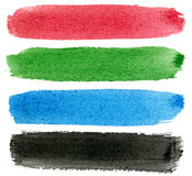 Red, green, blue and black watercolor paint. Stock Photography