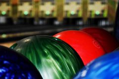 Red green blue bowling balls royalty free stock photo
