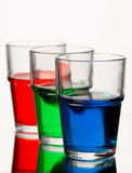 Red green blue coloured liquid. In three glasses Royalty Free Stock Photos