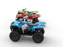 Red, green and blue four wheelers Stock Photos