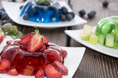 Red, green and blue Jello with fruits Stock Photo
