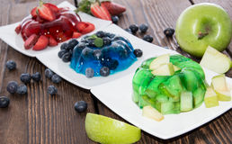 Red, green and blue Jello with fruits Royalty Free Stock Photos