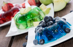 Red, green and blue Jello with fruits Stock Images
