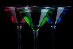Red, green, and blue martini glasses Stock Photos