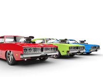 Red, green and blue muscle cars in a row Royalty Free Stock Photo