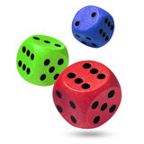 Red, green and blue rolling dices on white Royalty Free Stock Photography
