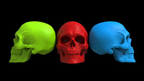 Red, green and blue skulls Stock Photos