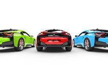 Red, Green and Blue sports cars - back view Stock Images