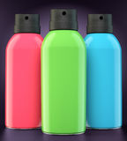 Red, green and blue spray cans Royalty Free Stock Photography