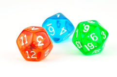Red, Green, and Blue Translucent Dice on White Stock Image