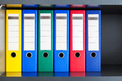 Red, green, blue and yellow office folders Stock Photography