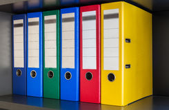 Red, green, blue and yellow office folders Royalty Free Stock Photos
