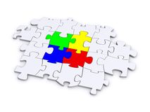 Red Green, Blue, and Yellow Puzzle. 3D render of a puzzle with a colored center Royalty Free Stock Image