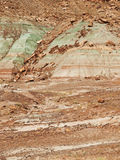 Red, green and brown rock layers eroding Stock Photos