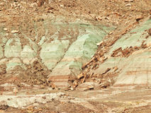 Red, green and brown rock layers eroding Royalty Free Stock Photography